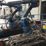 Used motoman XRC industrial robots on tracks